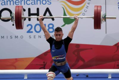 Carlos Berna le entregó al país el primer oro en pesas