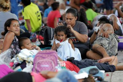 "Save the Children pide medidas ""urgentes"" para proteger niños de caravana hondureña"