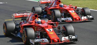 La escudería Ferrari hizo el uno - dos en la sesión de clasificación del Gran Premio de Hungría de Fórmula Uno, con el alemán Sebastian Vettel y el finlandés Kimi Räikkönen, superando a las 'Flechas Plateadas' de Mercedes Benz, del británico Lewis Hamilton y del finés Valterri Bottas.