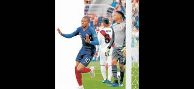 El francés Kylian Mbappé anotó el único gol del triunfo ante Perú y clasificó a su selección a los octavos de final del Mundial de Rusia 2018. El delantero de 19 años dijo que ya pasaron la página y piensan en el duelo de la última fecha ante Dinamarca.