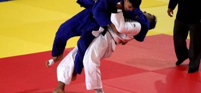 El santandereano Léider Farid Navarro Sánchez (azul), que entrena Johana Álvarez, logró hacerse a la medalla de bronce en la categoría de hasta 73 kilos de peso corporal del torneo de judo de los Juegos Centroamericanos y del Caribe.